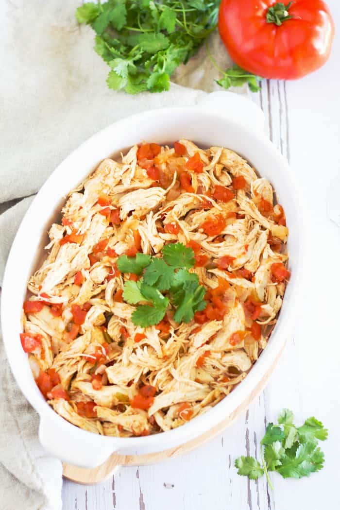 This 4 ingredient recipe for tender Mexican Shredded Chicken is so simple, so yummy, and so versatile