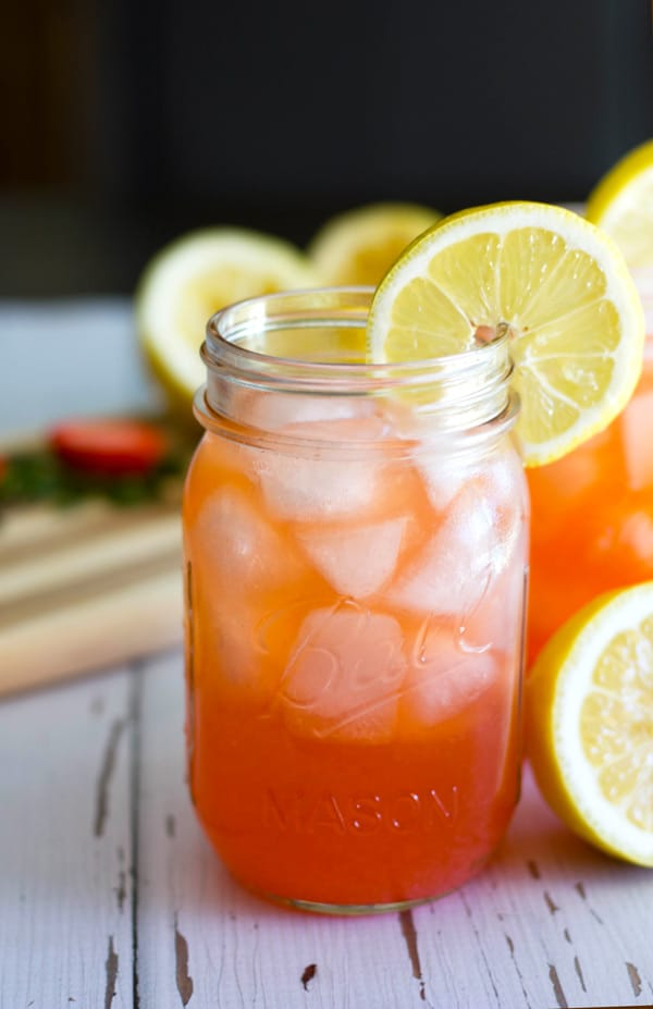This Sparkling Strawberry Lemonade Cocktail has the perfect amount of tart from the fresh squeezed lemon juice, sweetness from the puréed strawberries and sugar, and bubbles from the soda water. It is sure to put a smile on your face and a little pep in your step!