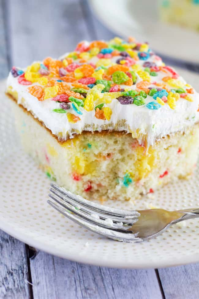 This recipe for Fruity Pebbles Funfetti Poke Cake couldn't be any easier, or any more tasty. It is the perfect poke cake recipe for kids and adults alike!