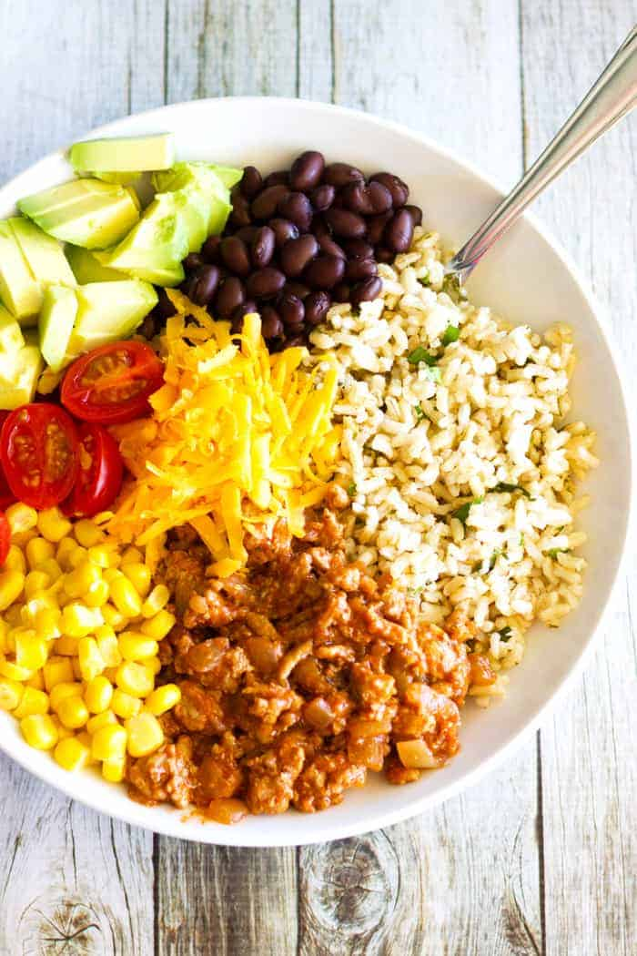 This yummy recipe for easy and healthy Turkey Taco Bowls with Cilantro Lime Rice is the perfect dinner option, or meal prep idea.