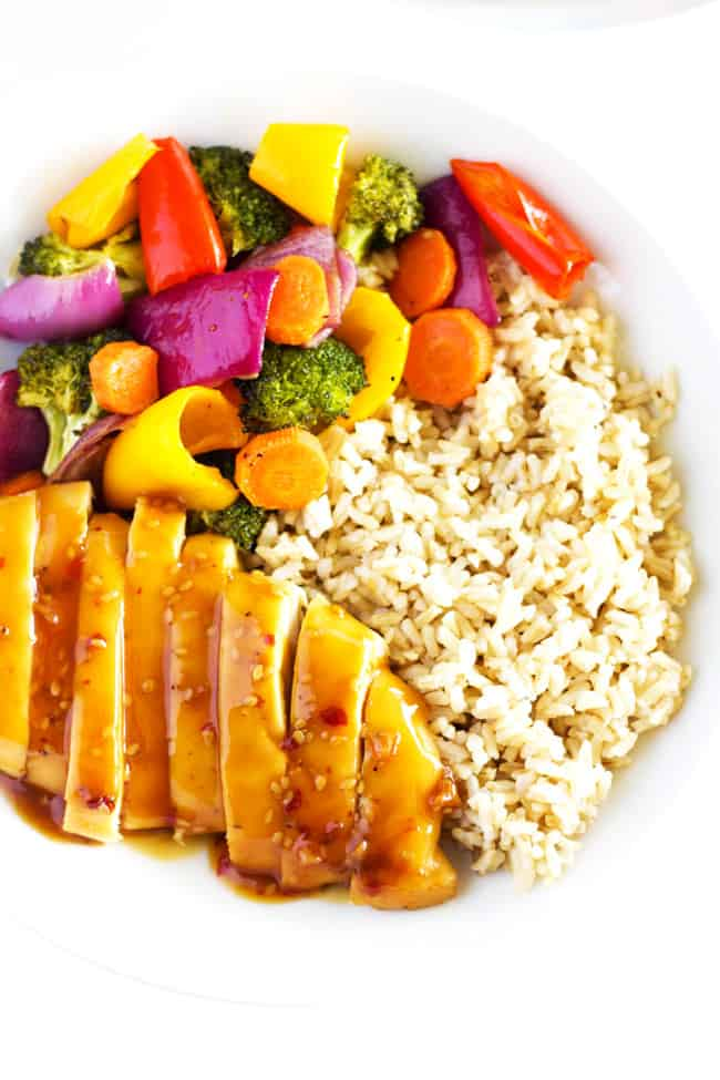 This healthy one pan chicken recipe features tender teriyaki chicken with flavorful roasted veggies and is perfect for meal prep or busy weekday meals!