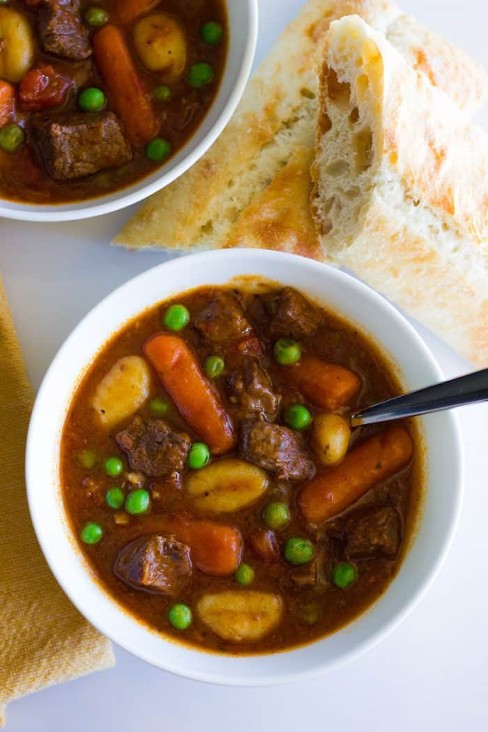 A quick and easy beef stew recipe made in the Instant Pot with tender beef, veggies and gnocchi in a rich and hearty gravy sauce.